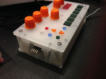 Close up of the Bastl Instruments sampler showing the connector and the velcro used to hold the devices together when linked.